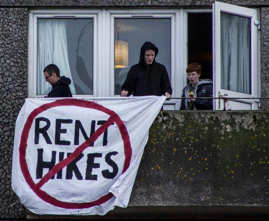 One of a number of banners being flown from the balconies of Ceder Street apartments in protest against hikes in rent